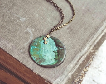 la luna necklace in green patina. a bohemian crescent moon face and star constellation statement necklace