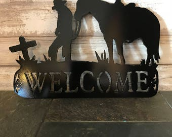 Cowboy at Cross Welcome Sign