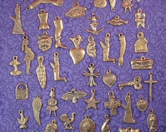 Ex votos MIlagros Hearts Charms 100 Assorted Antiqued Gold Tone Mexican Milagro Charm Ex Votos  Offerings Wholesale