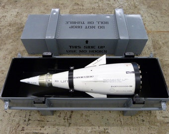 Inert Lockheed-Martin AGM-12b Bullpup air-to-ground missile nosecone/warhead with transport container.