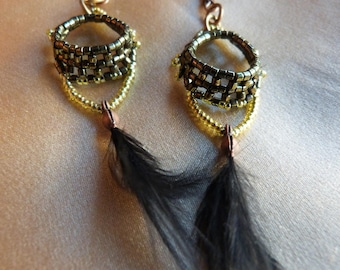 Black feathers and green beads earrings