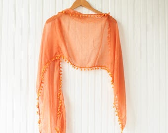 Orange 80s/90s sheer shawl with pom poms