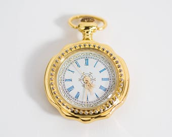 Gold Finish Pocket Watch with Blue Numbers and Gold Arm