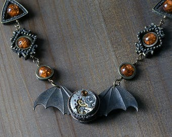 Steampunk Jewelry -  NECKLACE - Winged antique watch movement - Antique Bronze Copper , Lab created amber