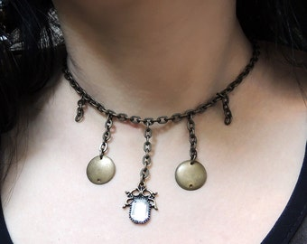 Handmade necklace with glass ornament, brass dots and chain
