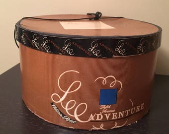 Vintage, oval hat box with string handle. Lee Adventure Fifth Avenue New York, Water Bloc 1930's