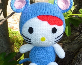 Hand crocheted doll in costume rat