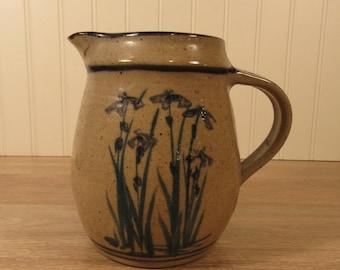 Salt glazed stoneware pitcher (signed) with iris floral design