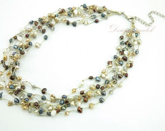 Brown freshwater pearl on silk necklace.