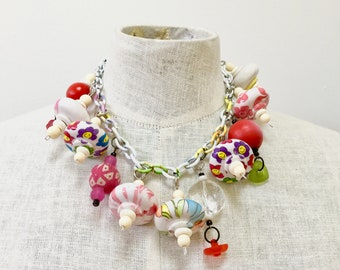porcelin charms-soft colors-hanging on a short necklace. Sweet and charming summer look-not heavy-vintage pieces.