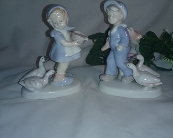 Set of two Boy and Girl with Geese Figurines,