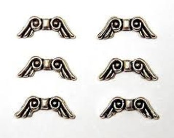 20 - 16 mm x 6 mm Angel Wing Beads/Silver Spacers