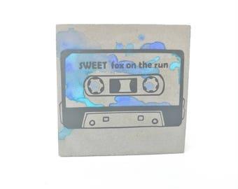 Retro cassette blue with desired title, concrete, concrete