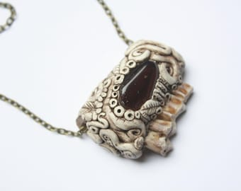 sheep mandible section adorned with clay and jasper stone wearable art by Dead Good Jewellery