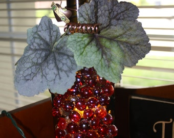 Wine bottle lamp with red grapes and wine leaves, copper wire and charm
