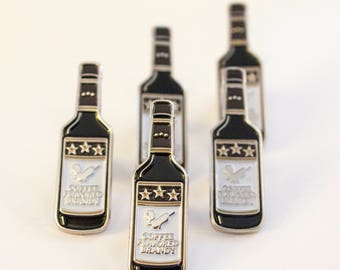 """The """"Champagne of Maine"""" Coffee Brandy Bottle Soft Enamel Pin"""