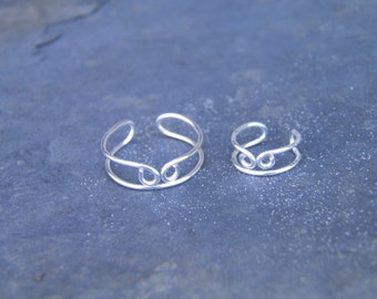 """Ear cuff, toe ring... """"Coming together"""" silver wire wrapped toe ring and ear cuff set."""