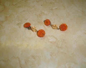 vintage clip on earrings orange lucite bead cluster dangles