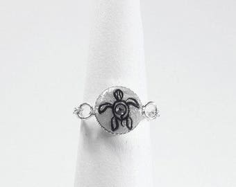 The turtle symbol chain ring
