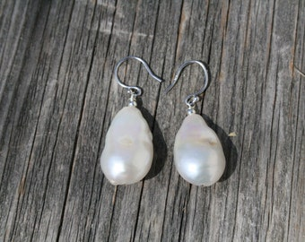 Large and Luminous Baroque pearl earrings. 16mm wide X 26mm high, on sterling silver wire