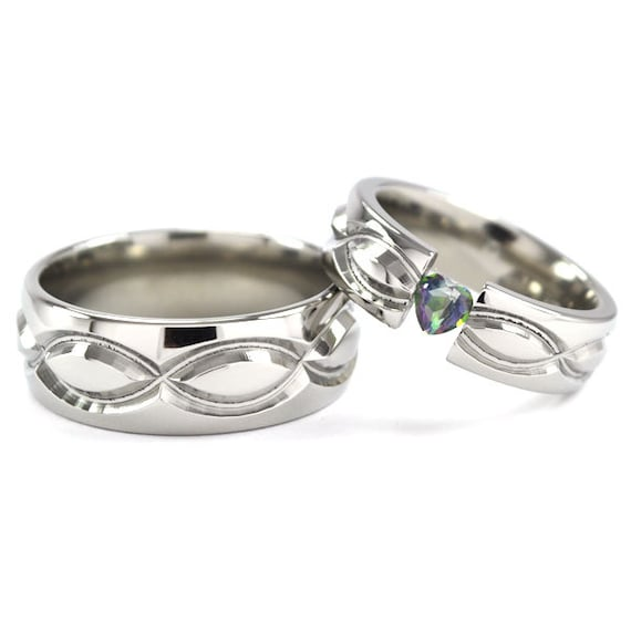 New Infinity His and Hers Tension Set Titanium Wedding Rings