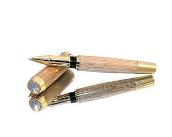 Wooden Rollerball Pen. This traditional pen has been handcrafted pen from a solid piece of Oak.