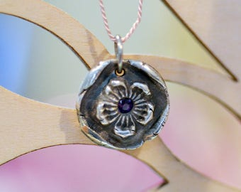 Silver cherry blossom pendant with sapphire center