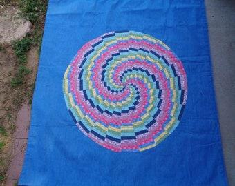 Spin wheel, quilt handcrafted on denim