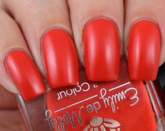 "Nail polish - ""Do You See?"" A bright orange based red creme"