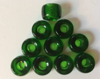 Czech glass crow roller pony beads in dark emerald green. 9 x 6 mm. with appox. 3.5 mm hole. Package contains 25 each.