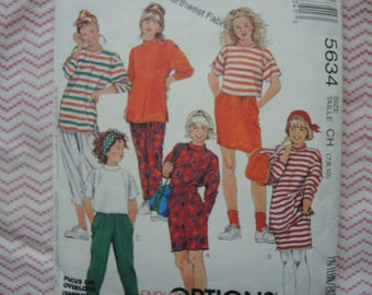 vintage 1990s McCalls sewing pattern 5634 girls' activewear dress or tunic or top skirt and pants in two lengths size 7-8-10