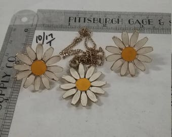 Used brass toned painted flower necklace and earring  set
