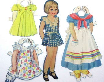 Vintage Paper Dolls Cute Little Girl Named Queenie and 3 Outfits Including Dutch Girl Costume