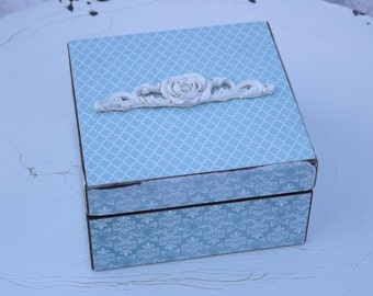 Shabby chic wooden box with hinged lid.