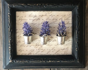 flowers in thimbles