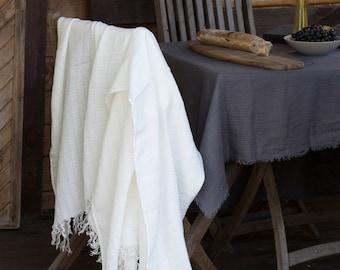 White natural linen throw blanket.