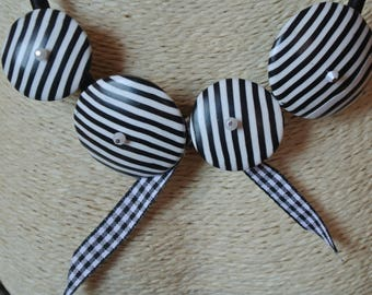 Necklace has black and white stripes and Ribbon