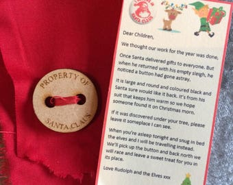 Santas lost button attached to part of his red coat comes complete with cuteness poem
