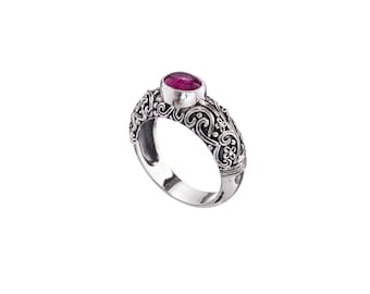 ring in sterling silver with pink tourmaline, engraved in traditional floral design