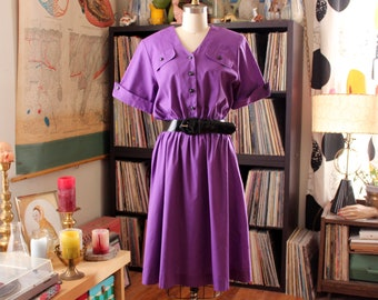 purple 1980s dress with black patent leather belt . 80s shirtdress with swing skirt