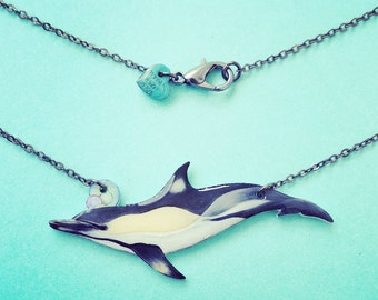 Common Dolphin glossy bib charm necklace on 19 inch chain is the perfect gift for any dolphin lover nature lover or Marine Biology student