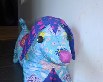 hand stiched bright weighted sausage dog doorstop or bookend
