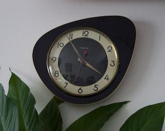 Pendulum clock featuring vintage