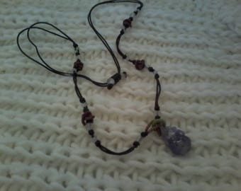 Beaded necklace with amethyst pendant