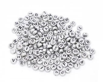500 Silver Alphabet beads and black 7mm