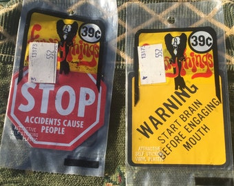 "Two 1969 ""Funny Things"" Vinyl Decal Stickers in Original Packages; Stop Sign and Warning Sign"