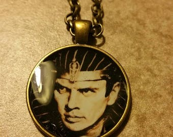 Pharoah Yul Brynner. Brass and residential pendant with chain.  Original portrait art by Fred Larucci.