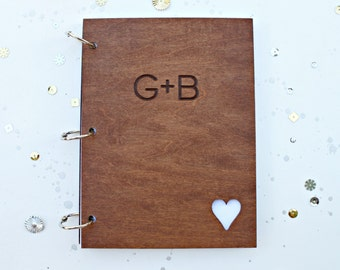 Custom wedding guest book with engraved initials and heart cutout