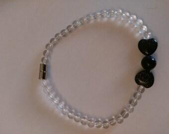 Rock Crystal bracelet with Onyx bow
