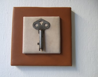 Striking and antique key, delicately mounted in fine leathers.